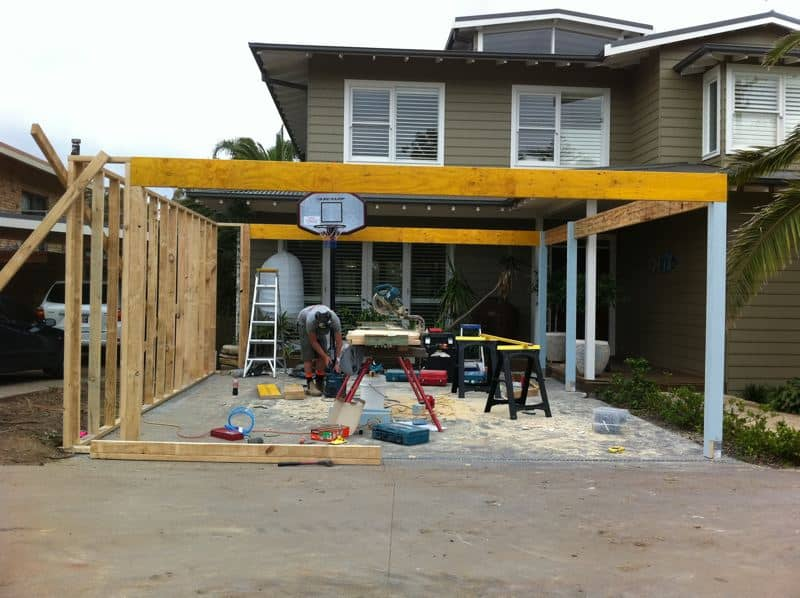 Image displaying carport frame being constructed