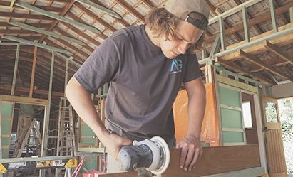 Image of an AAG team member working on a home renovation
